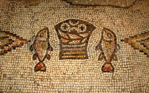 Mosaic of two fish and a basket of loaves inside Church in Tabgha, Israel